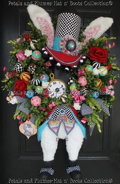 """Easter Wreath  My New 2012 Version of """"The Hatter Rabbit"""" Easter Wreath...The Reverse side of the Tag has a stamped """"Certificate of Authenticity"""" by Angie Etheridge of Petals & Plumes """"Like"""" us on Facebook at https://www.facebook.com/petalsnplumes"""