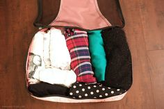 8 shirts (4 tanks, 4 tops)     1 cardigan     1 hoodie     2 pants     1 pair of shorts or skirt     1 dress (if applicable)     socks (take the # of days you'll likely wear socks and add +1)     undies (take the # of days of your trip and add +1)     bras (2 everyday bras, 1 strapless if applicable)     pajamas     1-3 outerwear (1 jacket, 1 blazer, 1 heavier coat if applicable)   Next, shoes:      1 pair of everyday sandals or flats     1 pair of nice heels     1 pair of boots   Jewelry &