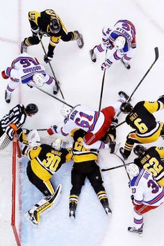 Cole laid out:   Pittsburgh Penguins goalie Matt Murray (30) and defenseman Ian Cole (28) dive on a loose puck surrounded by New York Rangers during the second period in Pittsburgh on April 23. The Penguins won the game 6-3 to take the series in five games.  -       © Gene J. Puskar/AP Photo