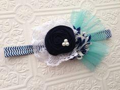 The Navy Swirl Headband or Hair Clip on Etsy, $13.50