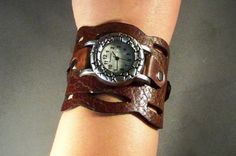Exclusive handmade watchband in vintage brown leather with a dynamic wave around it. This unique watchband is combined with an antique silver