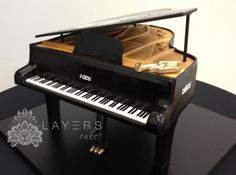 This grand piano cake is the key to a making your mouth sing. #grandpiano #cake