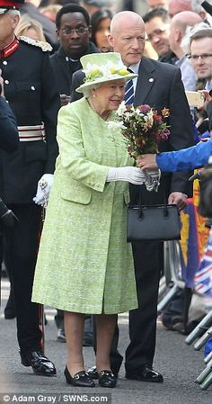 The Queen stepped out of her Windsor Castle home, where she has been staying during Easter...