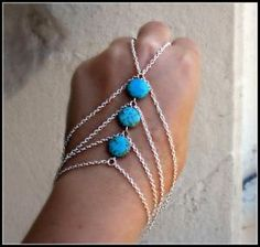 Silver slave bracelet with turquoise.
