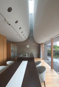 Juul House by NKS Architects - A curving roofline enhances acoustics inside this Japanese house.