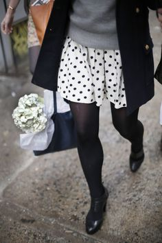 Black and white cute color scheme for cold weather. The quintessential navy tote. Also, fresh flowers. Also polka dots.