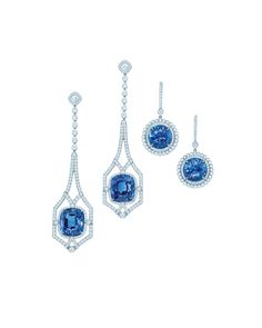 Tiffany diamond and sapphire earrings in platinum (from left): drop earrings with cushion-cut sapphires and diamonds, and with round sapphires and diamonds.