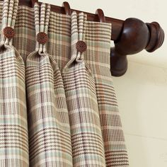 Hermes Plaid Curtain Panels.  I'm liking the leather buttons on each pinch pleat.