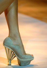 Christian Siriano. While I don't particularly like these, I love the creativity of these shoes :)