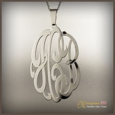 "This Personalized monogram necklace is  1.50"" x 1.0"" inch in diameter and about 0.75mm thick, made of solid sterling silver and Electroplated with a Choice of 18kt. Yellow gold, Pink Gold or White Rhodium Plating. Pendant suspends from a cable Link chain with 3 choices of length: 14"",16"" and 18"". The Monogram can be made with the initial of your choice.     Please use the note section available at checkout to let us know the Initial you would like personalized.  We believe that our quality…"