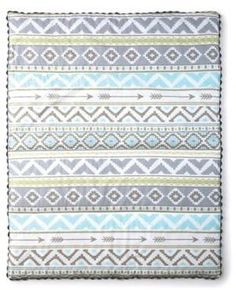 Baby Micah Quilt in Blue/Grey. This beautiful cotton quilt sports eye-catching shapes and arrows in aqua, yellow, and grey surrounded by rick-rack trim. affiliate