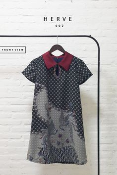 Contemporary Batik Design with Pearl Embellishment on Pendant Keyhole Trapezoid Dress  Length of Dress : 90 cm  Material Used : Contemporary Batik Design, Semi Silk. Pearl Embellishment  Standard Zipper Length (50-55cm) at the back