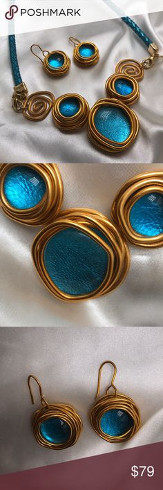 Beautiful Aqua Statement Necklace & Earrings These creative pieces were handmade in Israel. The aqua color is surrounded by turned gold wire. The aqua braided leather clips onto the piece. Matching earrings are just as beautiful Jewelry Necklaces