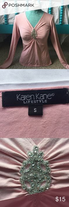 Karen Kane Pink Top Beautiful Karen Kane pink long sleeved top. Has a V neckline that dips down low and gathers in the front in a cluster of beautiful jewels. Very pretty! Great condition. Feel free to make me an offer! Karen Kane Tops Blouses