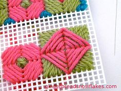 Plastic canvas; cross cushion by gingerbread_snowflakes, via Flickr