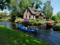 """Giethoorn Netherlands, has a nickname """"The Venice of Holland"""". The village has no motor-able roads, and all transport is done by water over one of the many intersecting canals. Oh The Places You'll Go, Places To Travel, Places To Visit, Beautiful World, Beautiful Places, Beautiful Homes, Wtf Fun Facts, Random Facts, Dream Vacations"""