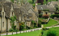 """""""The most beautiful village in England"""" - Bibury in Gloucestershire - The picturesque stone cottages of Arlington Row were built in 1380 originally as a monastic wool store but later converted into a row of cottages for weavers in the century. The Places Youll Go, Places To See, Villa Romaine, Arlington Row, Visit Britain, Stone Cottages, Stone Houses, Small Cottages, Natural Homes"""