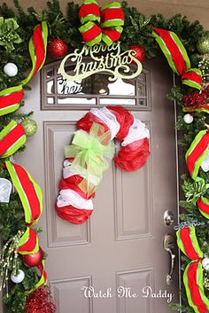 Candy cane wreath made from wire coat hangers and craft mesh.