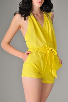 a1a43b3616d This sleeveless sexy tunic halter romper has a low back design with pockets  and a sash belted tie at the waist.