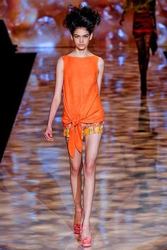 Badgley Mischka orange drop-waisted orange tie top and graphic shorts