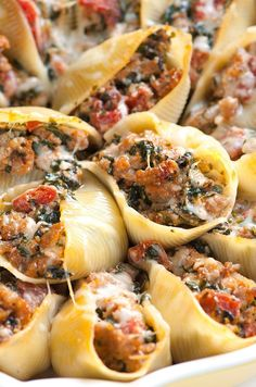 This family-friendly stuffed shells recipe with spinach, sausage, tomato and…