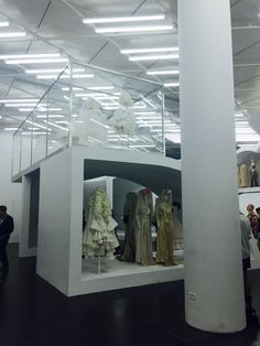 Then/Now display featuring the Broken Bride, White Drama, and Ceremony of Separation collections by Rei Kawakubo/Comme des Garçons.