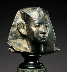 Granodiorite Head of a Statue of Amenemhat III,Middle Kingdom, 12th Dynasty (ca. 1859-1813 B.C.)Pharoah Amenemhat III here wears a nemes headdress,a folded and pleated piece of cloth generally reserved for the pharaoh.