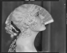 Peggy Hamilton posing with an open fan, 1930, UCLA, Library Special Collection