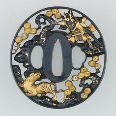 """Tsuba"" Japan. Edo Period (18th century). Iron, copper-gold alloy, and silver."