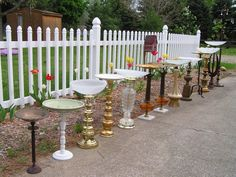 Lamp birdbaths lined up before going to the craft fair!