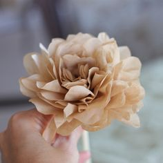 Step-by-step instructions on how to create roses out of coffee filters, masking tape, and drinking straws! So simple!