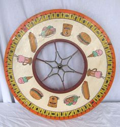 antique game wheel...love the food selection theme