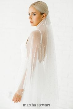 Pearls are the latest bridal trend, from big-day barrettes and button-down backs to veils. This option by Alyssa Kristin was composed of a simple, traditional base, but accented with the modern pearls. The bride wore the accessory low, place towards the top of her sleek bun, for another contemporary touch. #weddingideas #wedding #marthstewartwedding #weddingplanning #weddingchecklist Blue Wedding Dresses, Boho Wedding Dress, Wedding Veils, Wedding Bride, Wedding Ideas, Wedding Planning, Dream Wedding, Princess Wedding, Wedding Things