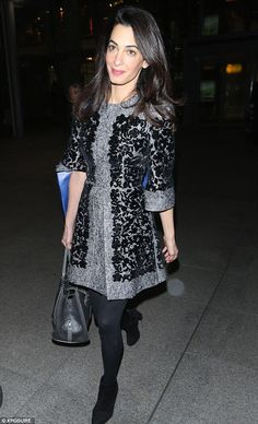 Making an entrance: Mrs Clooney was typically sophisticated  at Heathrow Airport on Monday...