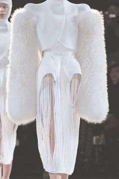 a futuristic avant garde couture outfit in sculptural cashmere and neoprene with fluted peplums and fox-fur sleeves - mugler f/w 2012 rtw