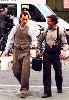 """Jude Law and Robert Downey Jr. on the set of """"Sherlock Holmes"""" (2009)."""