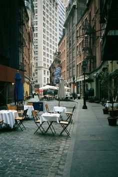 STONE STREET~ the oldest paved street in NYC, with the original cobblestones. Lined with restaurants and cafés, set with outdoor tables, this little pedestrian street is a quiet respite from the traffic of the city. Financial District, NYC