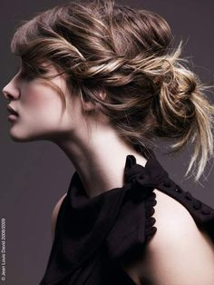 Lazy braided messy bun.  Twist-braid on one side and pin up... Well... Lazily!