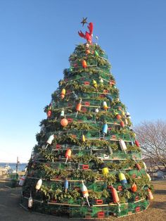 My favorite!  The Rockland, ME lobster trap tree.  Love the lobster holding the star at the top.  Magical!