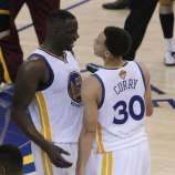 Draymond Green (23) and Stephen Curry (30) celebrate after the Warriors defeated the Cavaliers 108-100 in Game 1 of the NBA Finals between the Golden State Warriors and the Cleveland Cavaliers at Oracle Arena in Oakland, Calif., on Thursday, June 4, 2015.