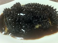 Braised sea cucumber with abalone sauce