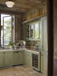 I kinda love how they make this kitchen look rustic and modern at the same time.  Magic!
