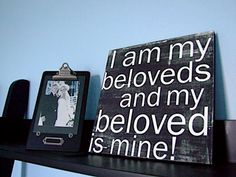 putting this verse on a chalk board frame from the wedding and putting it with my bouquet, and our sand. :)