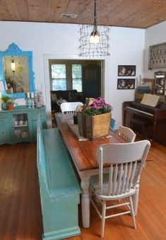 The turquoise mirror in the background was gold when Tanya Rogers purchased it for $175. She said it is one of the most expensive things she's ever bought. A church pew is repuposed as a bench at the dining table in the New Braunfels home. Photo: Robin Jerstad, Freelance