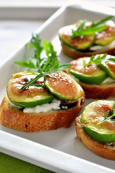This recipe for honey roasted fig and burrata crostini makes a creamy, dreamy sweet and salty appetizer. And it's easy! I sliced a baguette and toasted the slices with a little olive oil, brushed some fig slices with a little local honey and broiled them in the oven, then topped the crostini with burrata, the honey-roasted figs and drizzled a little balsamic vinegar on top.  www.flavourandsavour.com