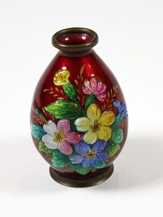 A petit vase~By Camille Faure~Floral hand enamel over a copper body~Made in France~Circa 1925