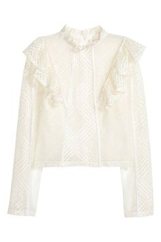 Soft lace blouse with a stand-up collar and opening with a covered button at the back of the neck, frill details and long sleeves. The blouse is lined but h Working Girl, White Ruffle Blouse, Ruffle Shirt, Ruffle Sleeve, Flutter Sleeve, Colorful Fashion, Ideias Fashion, Long Sleeve Tops, Glamour