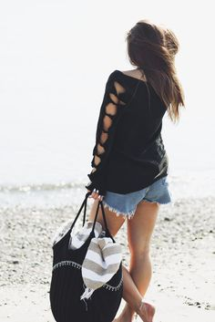 The perfect top to take you from the beach into the fall season. Jaleh's 'Della' Bows Top. Available in black and white @ jalehclothing.com. Made in USA.