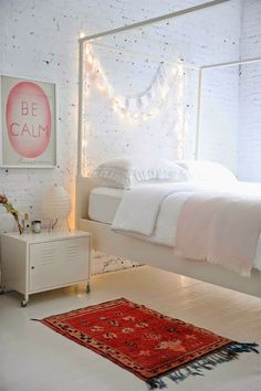 white brick wallpaper and a white wood lament. chic loft look for a girls room. princess it up for her little years and turn it grey and pink or yellow once she's a bit older