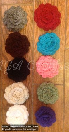 Crocheted flowers with alligator clips. (Have matching boot cuffs and headbands)  Limited offer.  Flowers can clip to headbands, scarves, hair, and other items! Www.facebook.com/agacrochet